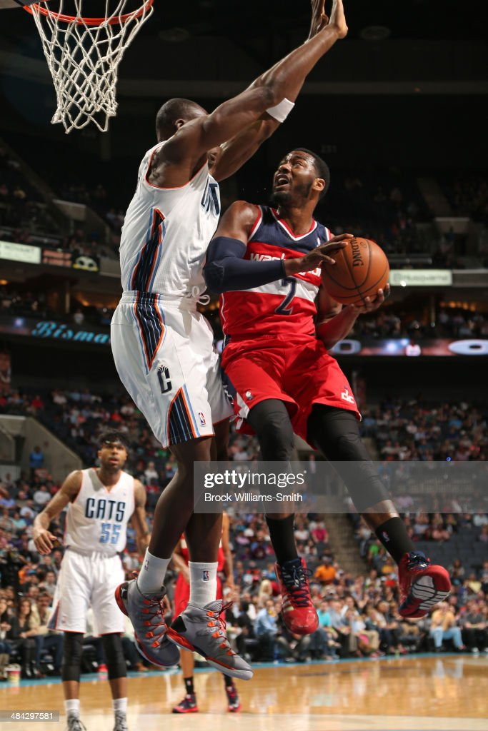 <a gi-track='captionPersonalityLinkClicked' href=/galleries/search?phrase=John+Wall&family=editorial&specificpeople=2265812 ng-click='$event.stopPropagation()'>John Wall</a> #2 of the Washington Wizards goes up for a shot against the Charlotte Bobcats during the game at the Time Warner Cable Arena on March 31, 2014 in Charlotte, North Carolina.