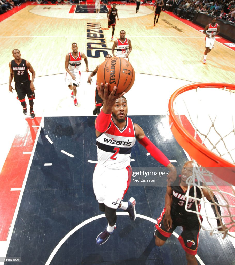 <a gi-track='captionPersonalityLinkClicked' href=/galleries/search?phrase=John+Wall&family=editorial&specificpeople=2265812 ng-click='$event.stopPropagation()'>John Wall</a> #2 of the Washington Wizards goes up for a shot against the Miami Heat during the game at the Verizon Center on April 14, 2014 in Washington, DC.