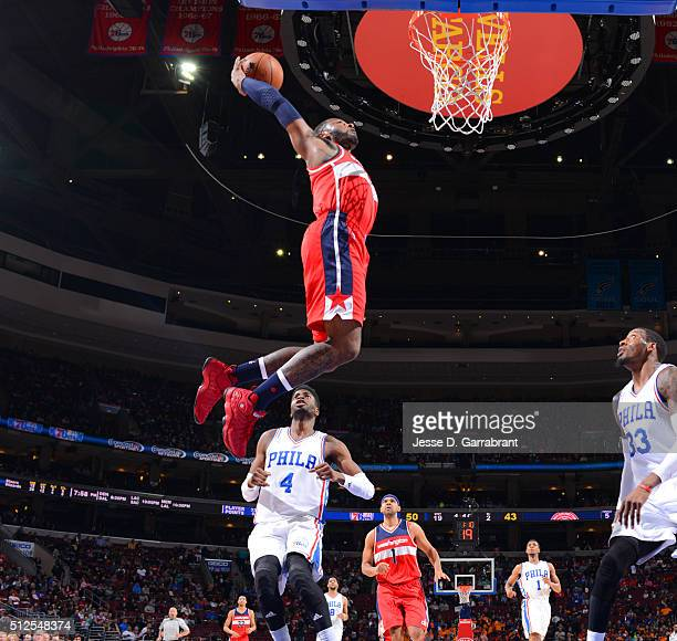 John Wall of the Washington Wizards goes up for the dunk against the Philadelphia 76ers at Wells Fargo Center on February 26 2016 in Philadelphia...