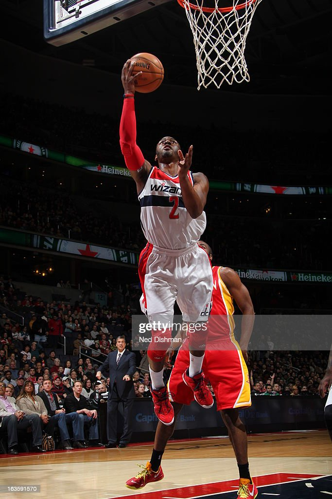 <a gi-track='captionPersonalityLinkClicked' href=/galleries/search?phrase=John+Wall&family=editorial&specificpeople=2265812 ng-click='$event.stopPropagation()'>John Wall</a> #2 of the Washington Wizards goes up for the layup against the Houston Rockets during the game at the Verizon Center on February 23, 2013 in Washington, DC.