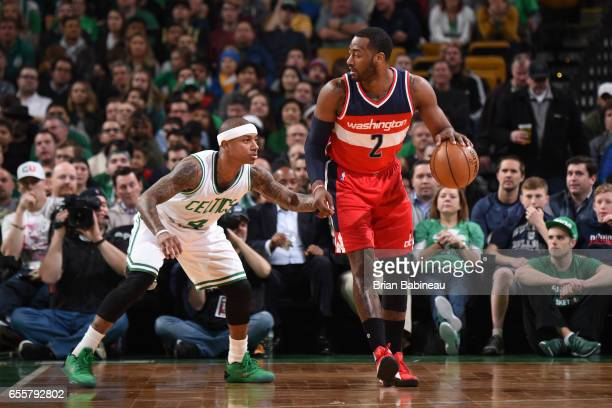 John Wall of the Washington Wizards handles the ball against Isaiah Thomas of the Boston Celtics on March 20 2017 at the TD Garden in Boston...
