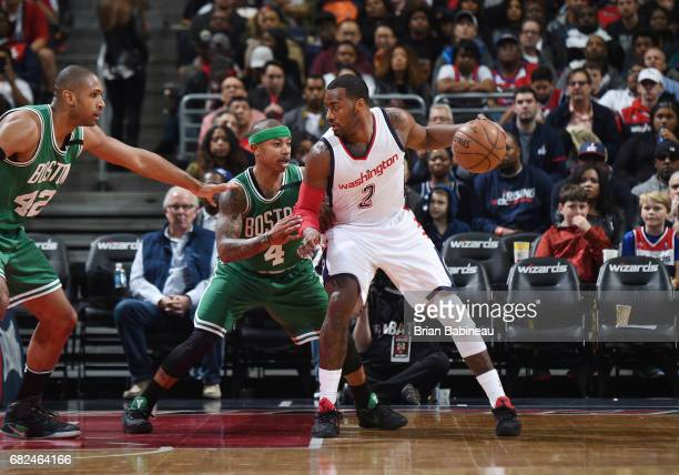 John Wall of the Washington Wizards handles the ball against Isaiah Thomas of the Boston Celtics during Game Six of the Eastern Conference Semifinals...