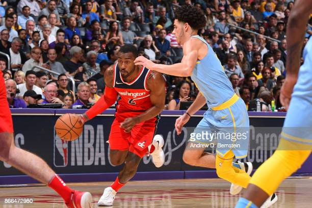 John Wall of the Washington Wizards handles the ball against Lonzo Ball of the Los Angeles Lakers on October 25 2017 at STAPLES Center in Los Angeles...