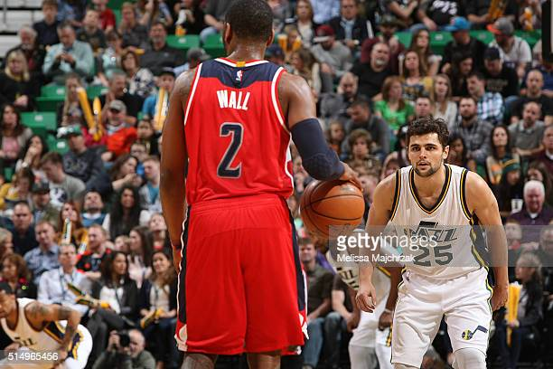 John Wall of the Washington Wizards handles the ball against Raul Neto of the Utah Jazz on March 10 2016 at vivintSmartHome Arena in Salt Lake City...