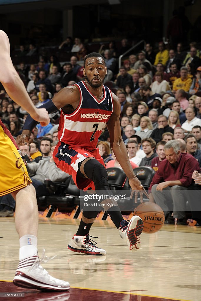 <a gi-track='captionPersonalityLinkClicked' href=/galleries/search?phrase=John+Wall&family=editorial&specificpeople=2265812 ng-click='$event.stopPropagation()'>John Wall</a> #2 of the Washington Wizards handles the ball against the Cleveland Cavaliers at The Quicken Loans Arena on February 23, 2014 in Cleveland, Ohio.