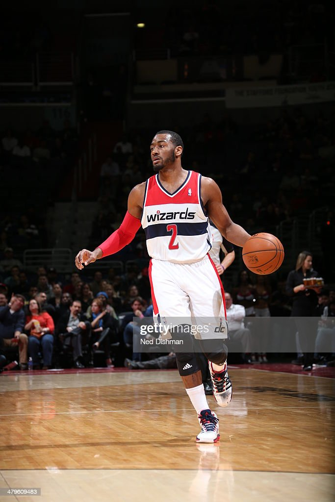 <a gi-track='captionPersonalityLinkClicked' href=/galleries/search?phrase=John+Wall&family=editorial&specificpeople=2265812 ng-click='$event.stopPropagation()'>John Wall</a> #2 of the Washington Wizards handles the ball against the Memphis Grizzlies at the Verizon Center on March 3, 2014 in Washington, DC.