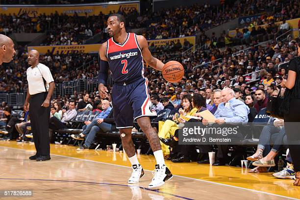 John Wall of the Washington Wizards handles the ball against the Los Angeles Lakers on March 27 2016 at STAPLES Center in Los Angeles California NOTE...