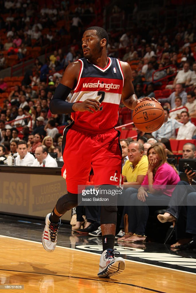 <a gi-track='captionPersonalityLinkClicked' href=/galleries/search?phrase=John+Wall&family=editorial&specificpeople=2265812 ng-click='$event.stopPropagation()'>John Wall</a> #2 of the Washington Wizards handles the ball against the Miami Heat on November 3, 2013 at American Airlines Arena in Miami, Florida.