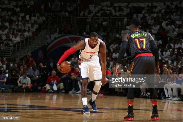 John Wall of the Washington Wizards handles the ball against the Atlanta Hawks during the Eastern Conference Quarterfinals of the 2017 NBA Playoffs...