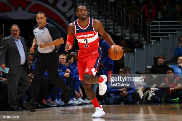 John Wall of the Washington Wizards handles the ball during game against the Detroit Pistons on October 20 2017 at Capital One Arena in Washington DC...