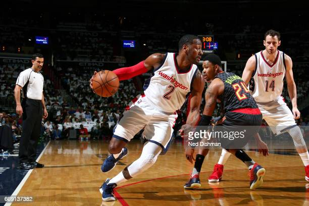 John Wall of the Washington Wizards handles the ball during the game against the Atlanta Hawks during the Eastern Conference Quaterfinals of the 2017...