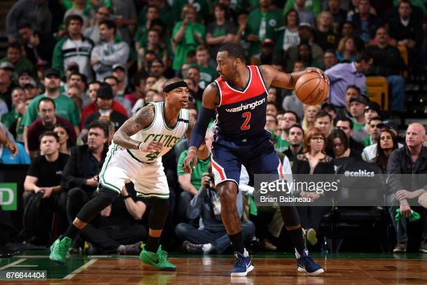 John Wall of the Washington Wizards handles the ball during the game against Isaiah Thomas of the Boston Celtics during Game Two of the Eastern...