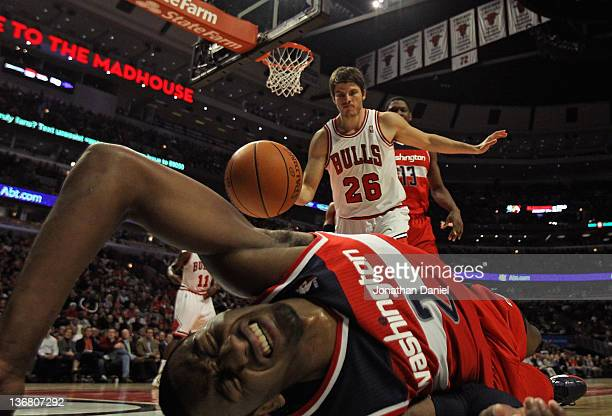 John Wall of the Washington Wizards hits the floor after taking a shot against Kyle Korver of the Chicago Bulls at the United Center on January 11...