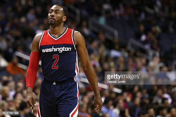 John Wall of the Washington Wizards looks on against the Miami Heat during the first half at Verizon Center on January 3 2016 in Washington DC NOTE...