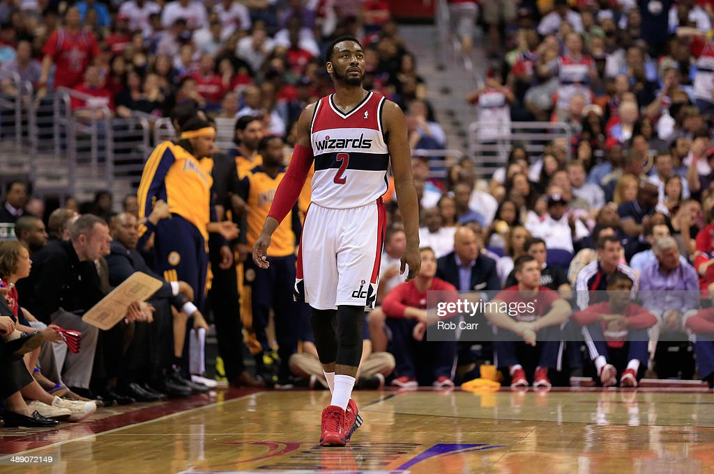 John Wall #2 of the Washington Wizards looks on during the second half of the Wizards 85-63 loss to the Indiana Pacers during Game 3 of the Eastern Conference Semifinals during the 2014 NBA Playoffs at Verizon Center on May 9, 2014 in Washington, DC.