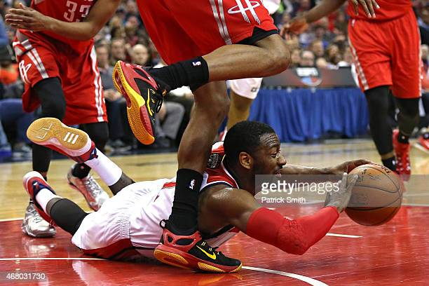 John Wall of the Washington Wizards looks to pass the ball against the Houston Rockets in the second half at Verizon Center on March 29 2015 in...