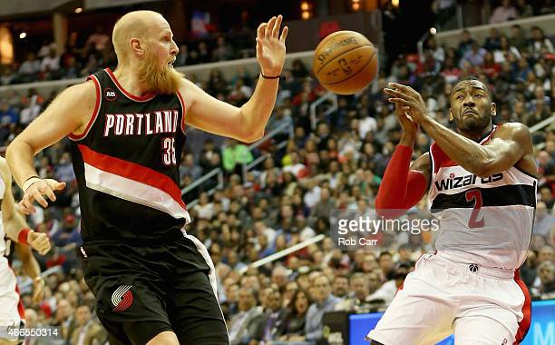 John Wall of the Washington Wizards looses the ball while being guarded by Chris Kaman of the Portland Trail Blazers during the second half of the...