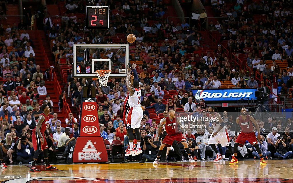 John Wall #2 of the Washington Wizards makes a late fourth quarter 3 pointer during a game against the Miami Heat at American Airlines Arena on December 19, 2014 in Miami, Florida.