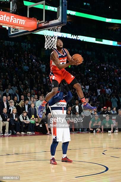 John Wall of the Washington Wizards participates in the Sprite Slam Dunk Contest on State Farm AllStar Saturday Night as part of the 2014 AllStar...