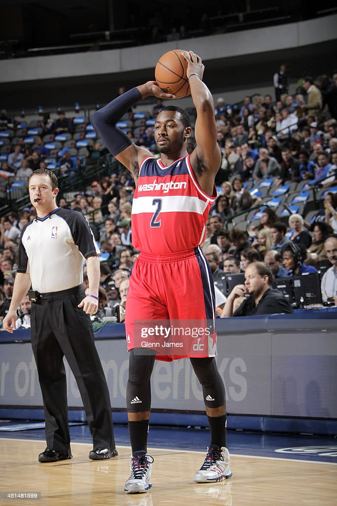 <a gi-track='captionPersonalityLinkClicked' href=/galleries/search?phrase=John+Wall&family=editorial&specificpeople=2265812 ng-click='$event.stopPropagation()'>John Wall</a> #2 of the Washington Wizards passes the ball against the Dallas Mavericks on November 12, 2013 at the American Airlines Center in Dallas, Texas.