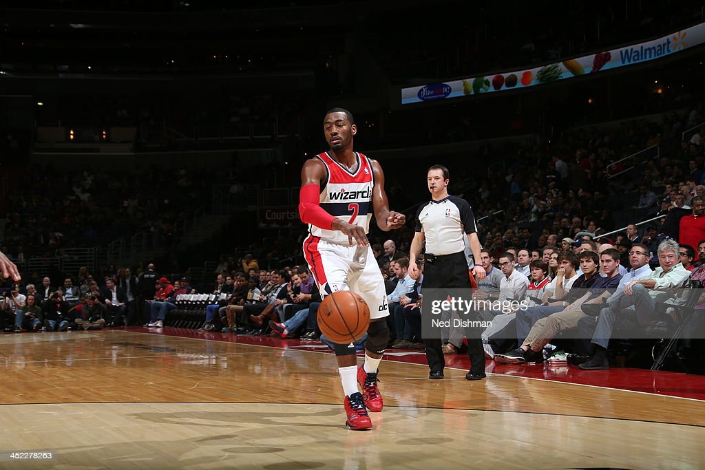<a gi-track='captionPersonalityLinkClicked' href=/galleries/search?phrase=John+Wall&family=editorial&specificpeople=2265812 ng-click='$event.stopPropagation()'>John Wall</a> #2 of the Washington Wizards passes the ball down low against the Minnesota Timberwolves during the game at the Verizon Center on November 19, 2013 in Washington, DC.