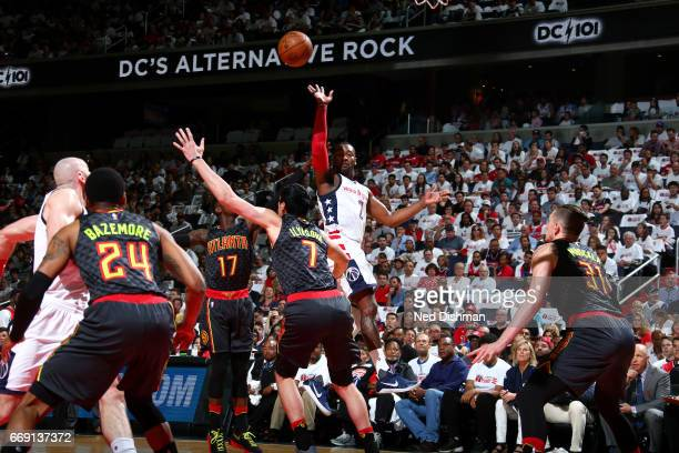 John Wall of the Washington Wizards passes the ball during the game against the Atlanta Hawks during the Eastern Conference Quarterfinals of the 2017...