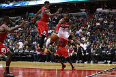 John Wall of the Washington Wizards passes the ball in front of Jimmy Butler of the Chicago Bulls in the second half of their 11796 win at Verizon...