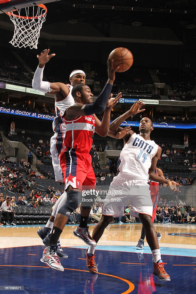 <a gi-track='captionPersonalityLinkClicked' href=/galleries/search?phrase=John+Wall&family=editorial&specificpeople=2265812 ng-click='$event.stopPropagation()'>John Wall</a> #2 of the Washington Wizards passes the ball out against the Charlotte Bobcats at the Time Warner Cable Arena on March 18, 2013 in Charlotte, North Carolina.