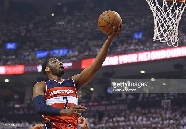 John Wall of the Washington Wizards p]goes up for a basket against the Toronto Raptors in Game One of the NBA Eastern Conference Quarterfinals at the...