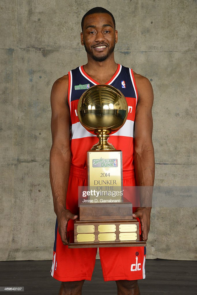 John Wall of the Washington Wizards poses for a portrait with the trophy of the dunker of the night after the East won the Sprite Slam Dunk Contest in the 2014 State Farm Saturday Night on February 15, 2014 at the Smoothie King Center in New Orleans, Louisiana.