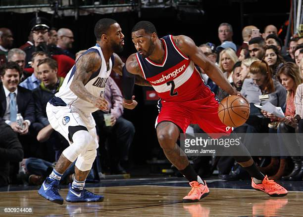 John Wall of the Washington Wizards posts up against Pierre Jackson of the Dallas Mavericks on January 3 2017 at the American Airlines Center in...