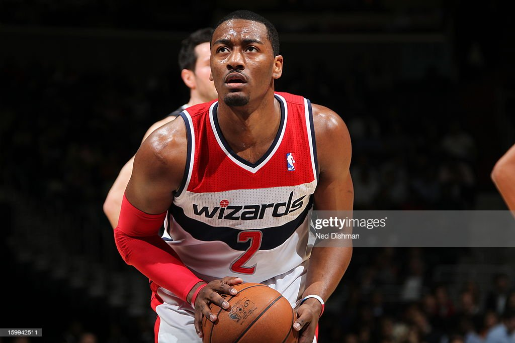 <a gi-track='captionPersonalityLinkClicked' href=/galleries/search?phrase=John+Wall&family=editorial&specificpeople=2265812 ng-click='$event.stopPropagation()'>John Wall</a> #2 of the Washington Wizards prepares the shoot a free throw during the game against the Orlando Magic at the Verizon Center on January 14, 2013 in Washington, DC.