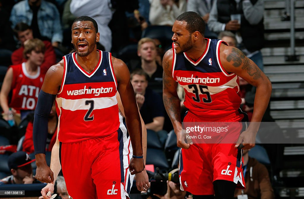 <a gi-track='captionPersonalityLinkClicked' href=/galleries/search?phrase=John+Wall&family=editorial&specificpeople=2265812 ng-click='$event.stopPropagation()'>John Wall</a> #2 of the Washington Wizards reacts after a basket against the Atlanta Hawks with <a gi-track='captionPersonalityLinkClicked' href=/galleries/search?phrase=Trevor+Booker&family=editorial&specificpeople=4123563 ng-click='$event.stopPropagation()'>Trevor Booker</a> #35 at Philips Arena on December 13, 2013 in Atlanta, Georgia.