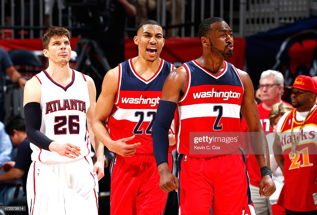 John Wall of the Washington Wizards reacts after assisting on a basket in the final seconds against the Atlanta Hawks during Game One of the Eastern...