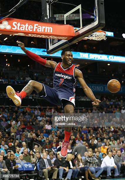 John Wall of the Washington Wizards reacts after dunking the ball during their game against the Charlotte Hornets at Time Warner Cable Arena on...