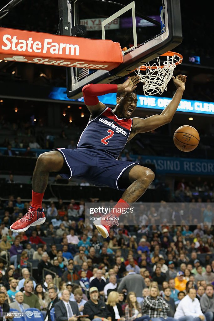 John Wall #2 of the Washington Wizards reacts after dunking the ball during their game against the Charlotte Hornets at Time Warner Cable Arena on November 25, 2015 in Charlotte, North Carolina. NBA -