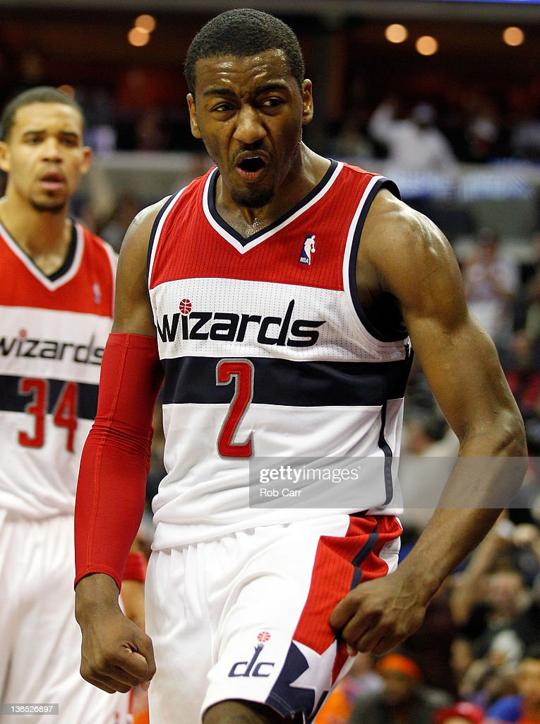 <a gi-track='captionPersonalityLinkClicked' href=/galleries/search?phrase=John+Wall&family=editorial&specificpeople=2265812 ng-click='$event.stopPropagation()'>John Wall</a> #2 of the Washington Wizards reacts after making a basket against the New York Knicks during the second half at Verizon Center on January 6, 2012 in Washington, DC.
