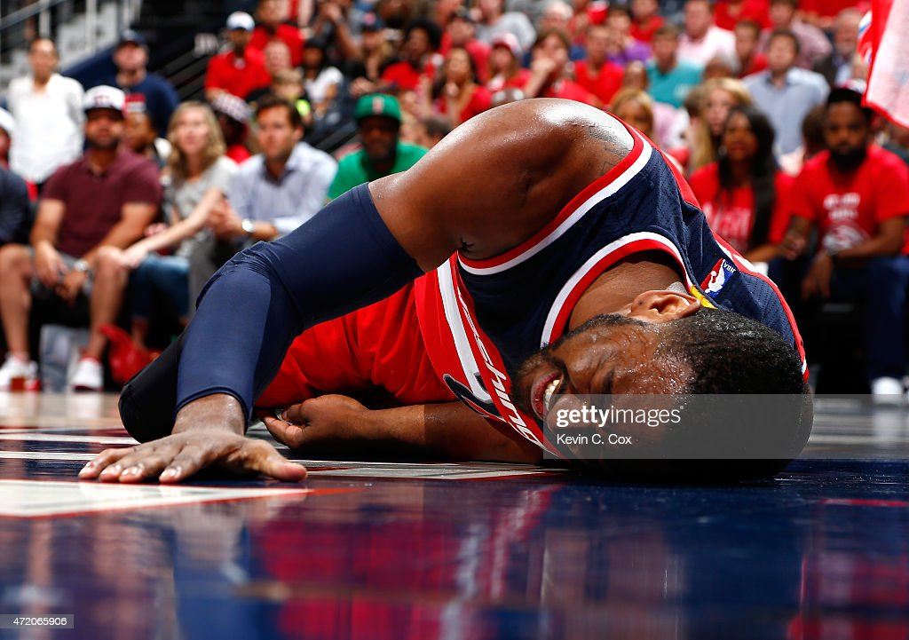 John Wall #2 of the Washington Wizards reacts after missing a basket and landing on the floor against the Atlanta Hawks during Game One of the Eastern Conference Semifinals of the 2015 NBA Playoffs at Philips Arena on May 3, 2015 in Atlanta, Georgia.