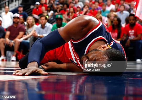 John Wall of the Washington Wizards reacts after missing a basket and landing on the floor against the Atlanta Hawks during Game One of the Eastern...