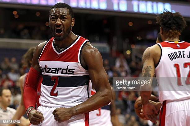 John Wall of the Washington Wizards reacts after scoring against the Chicago Bulls during the first half at Verizon Center on January 10 2017 in...