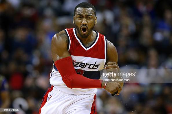 John Wall of the Washington Wizards reacts after scoring during the first half of a game against the New Orleans Pelicans at the Smoothie King Center...