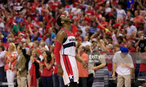 John Wall of the Washington Wizards reacts after scoring to end the first half against the Indiana Pacers during Game Four of the Eastern Conference...