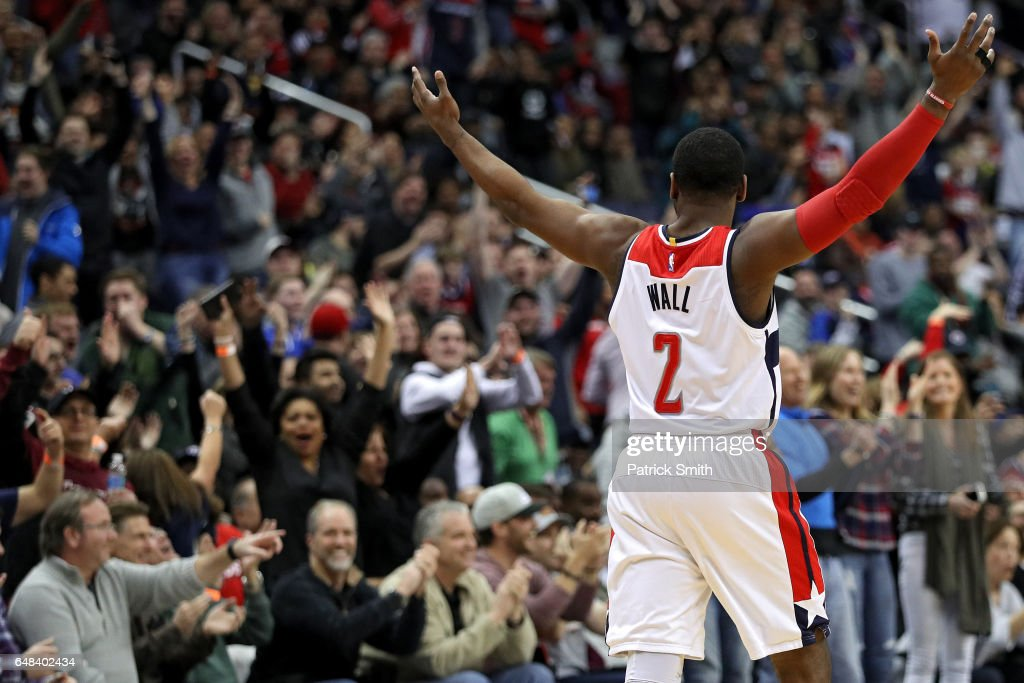 John Wall #2 of the Washington Wizards reacts after teammate Bojan Bogdanovic #44 (not pictured) scored the game-winning basket against the Orlando Magic during the second half at Verizon Center on March 5, 2017 in Washington, DC.