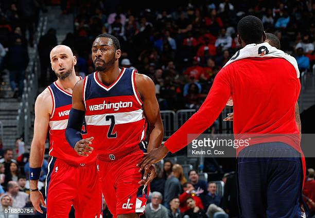 John Wall of the Washington Wizards reacts during a timeout against the Atlanta Hawks at Philips Arena on March 21 2016 in Atlanta Georgia NOTE TO...