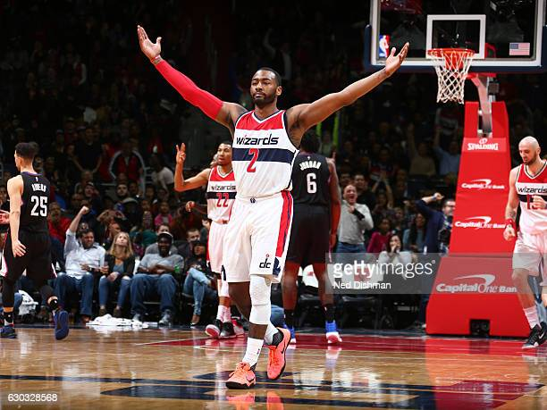 John Wall of the Washington Wizards reacts during the game against the LA Clippers on December 18 2016 at the Verizon Center in Washington DC NOTE TO...