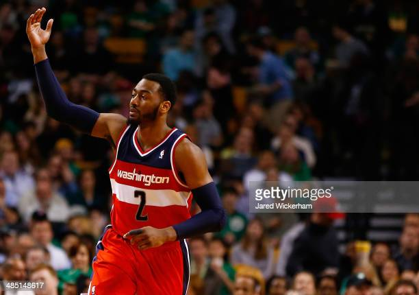 John Wall of the Washington Wizards reacts following a threepoint shot against the Boston Celtics in the second quarter during the game at TD Garden...