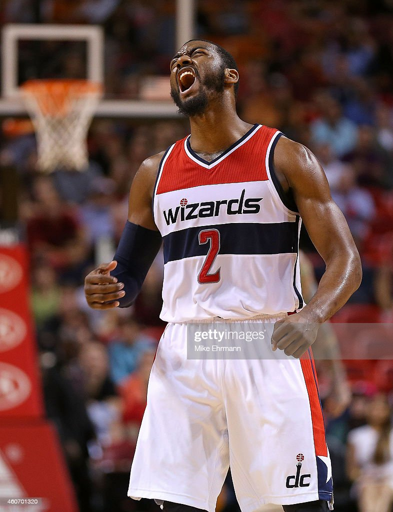 John Wall #2 of the Washington Wizards reacts to a late fourth quarter 3 pointer during a game against the Miami Heat at American Airlines Arena on December 19, 2014 in Miami, Florida.