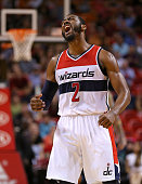 John Wall of the Washington Wizards reacts to a late fourth quarter 3 pointer during a game against the Miami Heat at American Airlines Arena on...