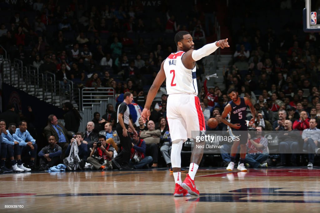John Wall #2 of the Washington Wizards reacts to a play during the game against the Memphis Grizzlies on December 13, 2017 at Capital One Arena in Washington, DC.