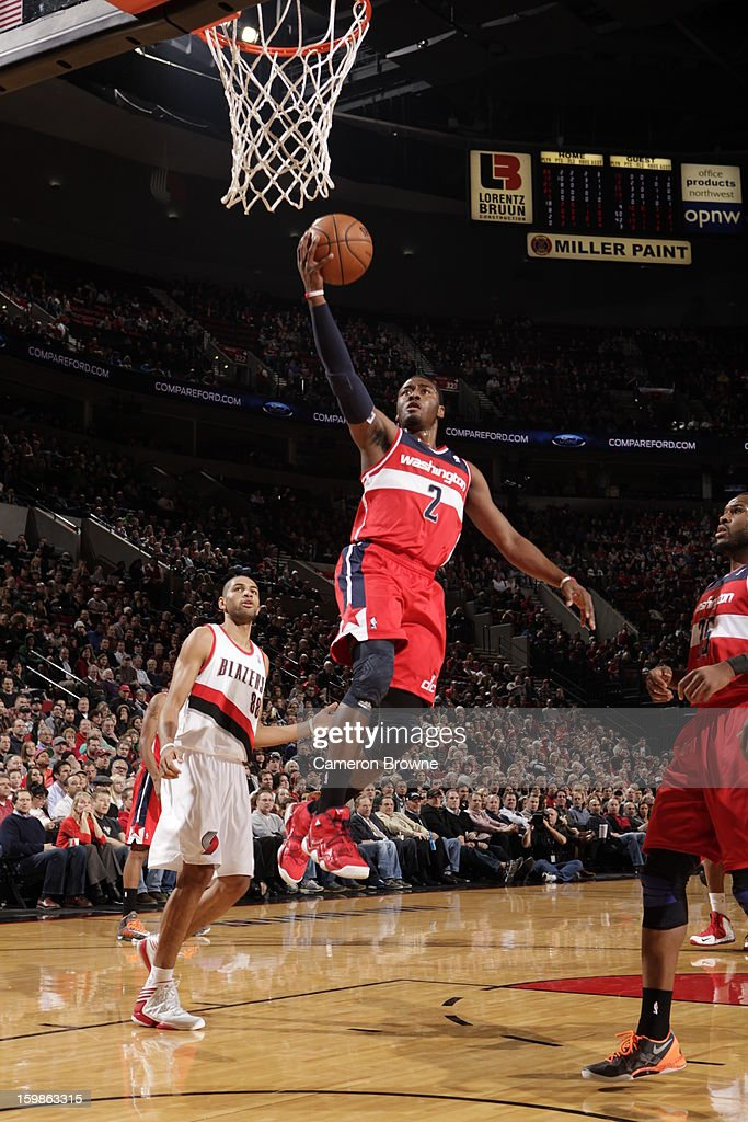 John Wall #2 of the Washington Wizards rises for a layup against the Portland Trail Blazers on January 21, 2013 at the Rose Garden Arena in Portland, Oregon.